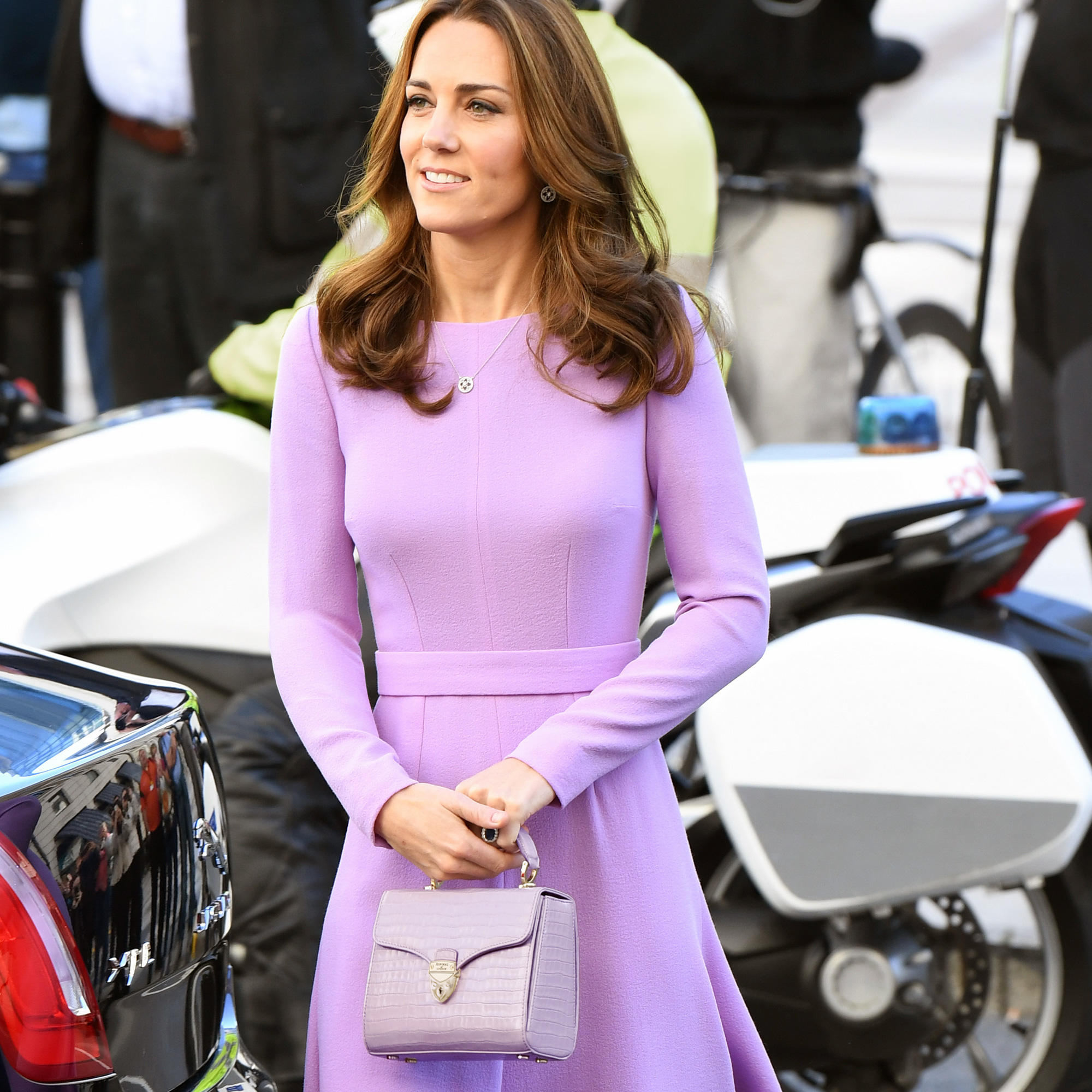 The Duchess of Cambridge in lavender Emilia Wickstead dress and carrying Aspinal of London Lavender bag