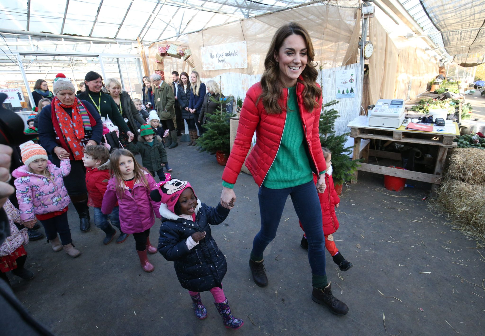 The Duchess of Cambridge dressed up in Christmas colours for Family Action Visit