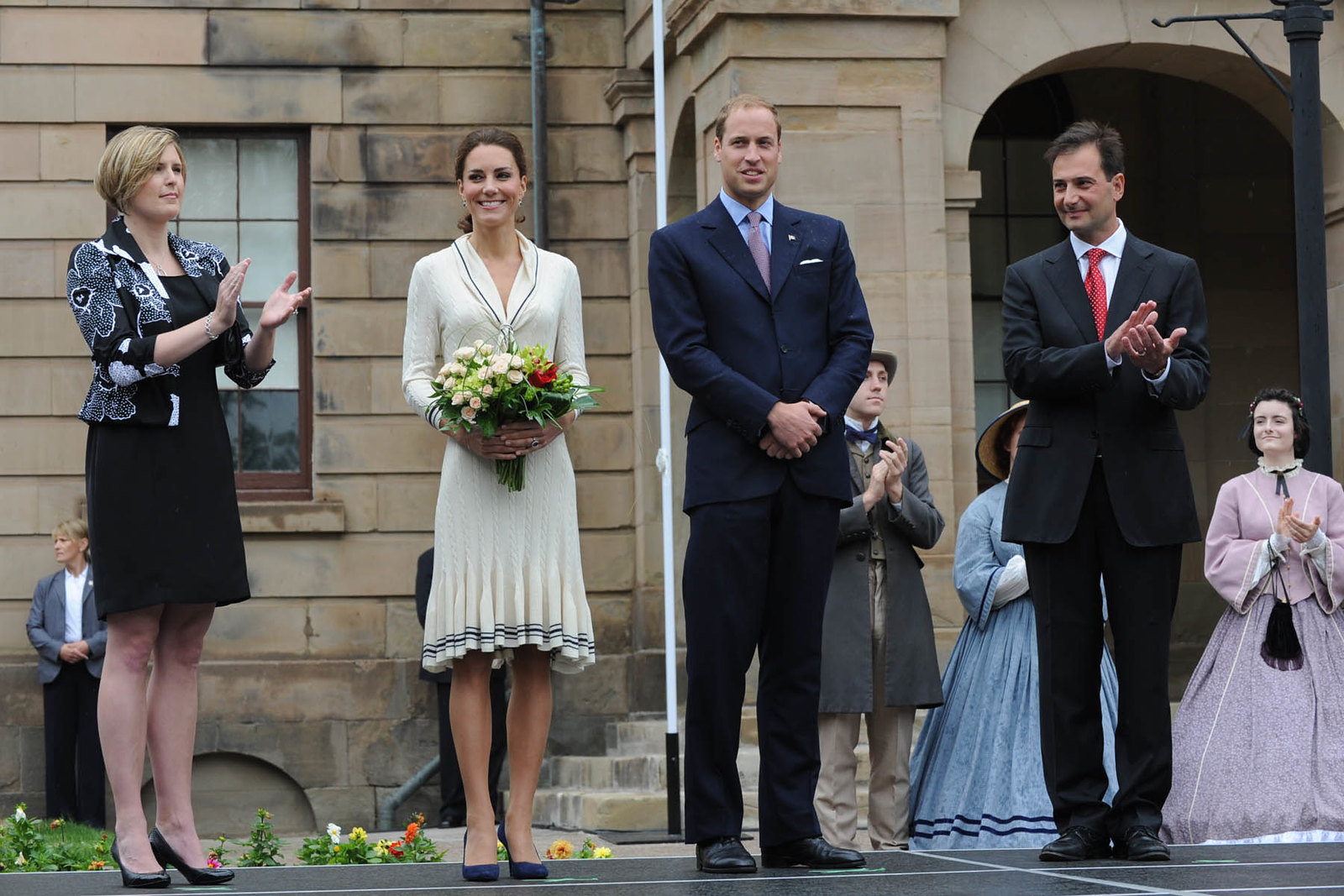 the Duchess of cambridge in white Alexander McQueen for Prince Edward Island