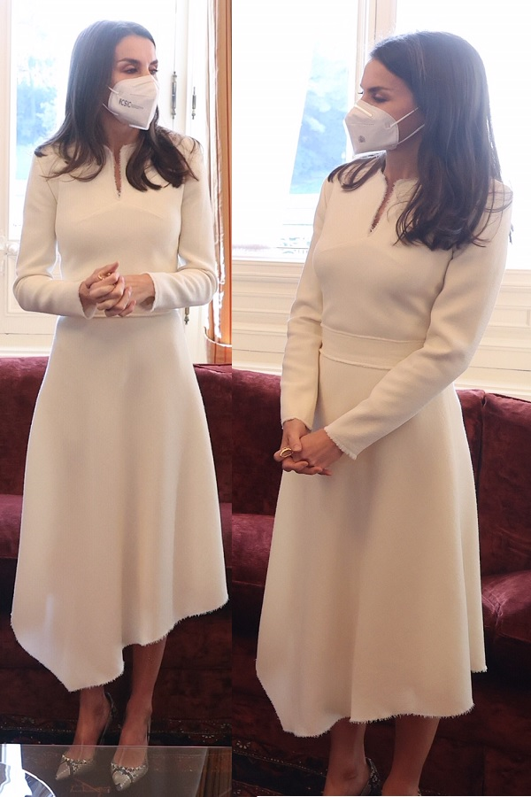 Queen Letizia wearing an off-white cream asymmetrical dress with frayed detailing